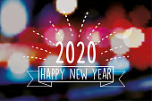 vintage new year 2020 line badge on blurred colorful background