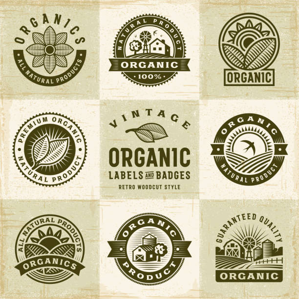 Vintage Organic Labels And Badges Set A set of vintage organic labels and badges in retro woodcut style. Editable EPS10 vector illustration with clipping mask and transparency. organic stock illustrations