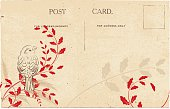 Vintage postcard with bird red silhouette holly sprig. Postcard, lettering & elements are on their layers for easier editing. Vintage Post Card with Rustic Background with empty stamp area and post mark in top right hand corner.  Post cards have an old style parchment rustic grunge look background.