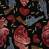 Vintage revolvers and red anatomical hearts template for clothes, textile t-shirt design. Creative fashion embroidery wild West, gangster love background. Embroidery guns and anatomical hearts