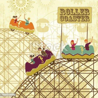Children enjoying a roller coaster in a amusement park.