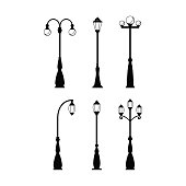 Vintage streetlights black silhouettes set. Vector retro street lamp lights isolated on white background