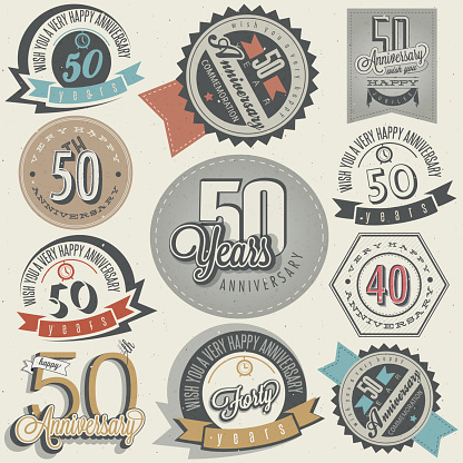 Fifty anniversary design in retro style. Vintage labels for anniversary greeting. Hand lettering style typographic and calligraphic symbols for 50 anniversary.