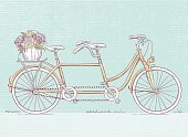 Yellow vector Vintage Retro tandem bicycle with flowers in rear basket. Hand drawn vector illustration of a bike for two in pen & ink sketch style. Color image perfect for wedding cards and invitations for friends.