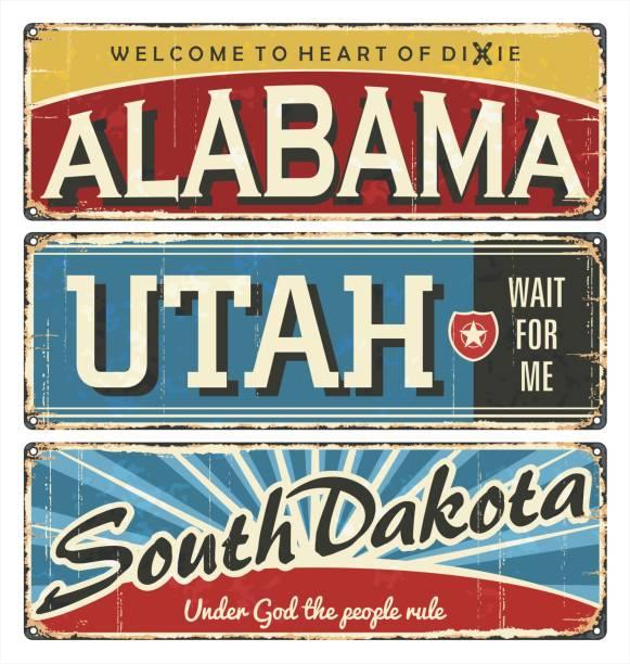 vintage tin sign collection with us title. alabama. utah. dakota. south. north. retro souvenirs or postcard templates on rust background. - alabama stock illustrations