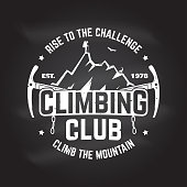 Climbing club badge. Vector. Concept for shirt, print, stamp or tee. Vintage typography design with ice axe, rock climbing Goat and mountain silhouette. Chalk drawing on a blackboard.