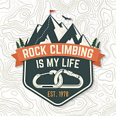 Rock Climbing is my life badge. Vector. Concept for shirt or icon, print, stamp or tee. Vintage typography design with carabiners, condor and mountain silhouette. Outdoors adventure.
