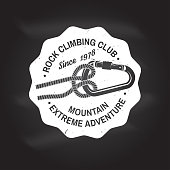 Rock Climbing club badge. Vector. Concept for shirt or icon, print, stamp or tee. Vintage typography design with knot for quickly tying a climbing rope and carabiner. Chalk drawing on a blackboard.