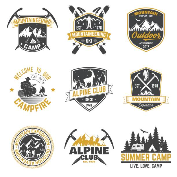 vintage typography design with mountaineers and mountain silhouette - wildlife travel stock illustrations, clip art, cartoons, & icons