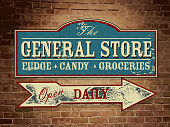 Vector illustration of a vintage, retro, old fashioned General Store wood sign hanging on a brick wall. Light blue, cream and red color scheme. Antique Signage, with text design. Fudge, Candy, Groceries. Open daily. Old fashioned nostalgia, printable. Store, shopping, antique, old days. Wall signage. Fully editable and printable. Arrow design.