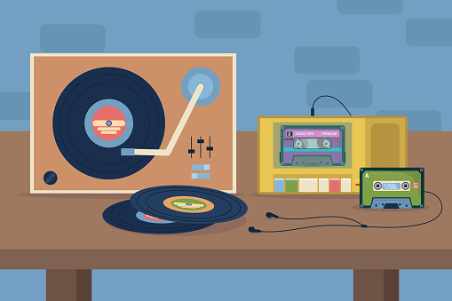 Vinyl and cassette players with earphones on table illustration