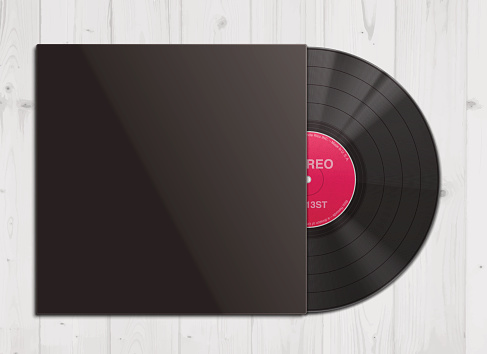 Vinyl record in cover on wooden background