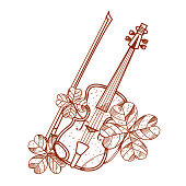 Violin with four-leaf clover.
