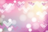 Vivid bokeh with hearts in soft color. Background with highlights. vector