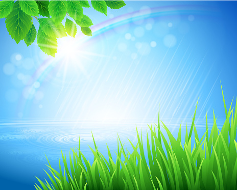 Vivid spring landscape with rainbow appearing in bokeh light