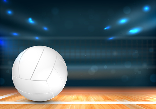 Volleyball ball in sport arena with net and lights