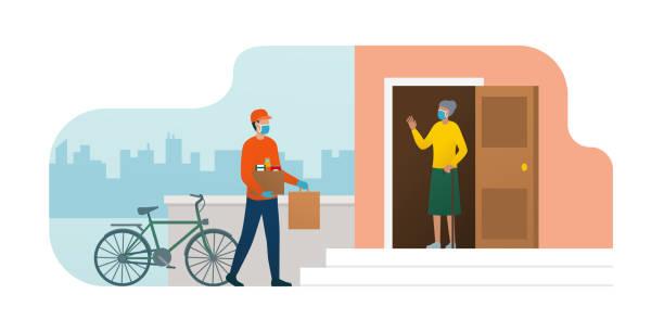 illustrazioni stock, clip art, cartoni animati e icone di tendenza di volunteer delivering food at home to a senior woman during coronavirus epidemic - grocery home