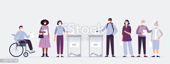 istock Voters in masks casting ballots at the polling place. Men and women putting paper ballots to election box. Election during a pandemic. 1267153109