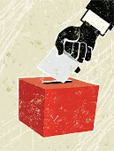 Vote Now! A stylized vector cartoon of a hand posting it's vote in a ballot box, the style is  reminiscent of an old screen print poster and suggesting, democracy, choice, election, voting or decisions. Hand, fingers, paper, ballot bo, paper texture and background are on different layers for easy editing. Please note: clipping paths have been used,  an eps version is included without the path.