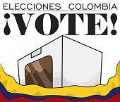 Poster with white voting box behind waving Colombian flag, promoting to vote in Electoral event (written in Spanish).