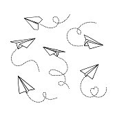 Vector set of hand drawn doodle paper airplane isolated on white background. Line icon symbol of travel and route.
