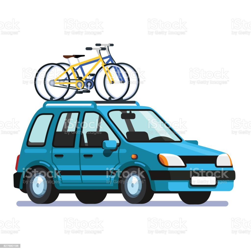 Wagon car with two bicycles mounted on roof rack