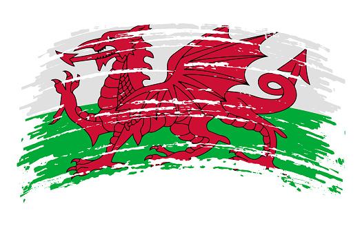 Wales flag in grunge brush stroke, vector