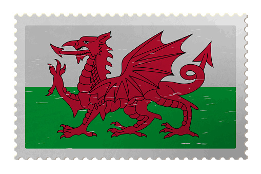 Wales flag on old postage stamp, vector