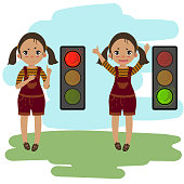Pedestrian traffic light. Girl shows and explains the rules of road safety. Red and green light. Attention on the road