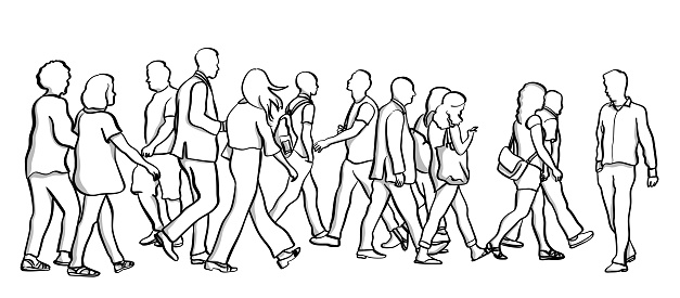 Man walking against a large crowd of pedestrian all going in the same direction