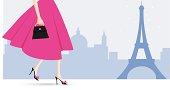 A woman walking in Paris.