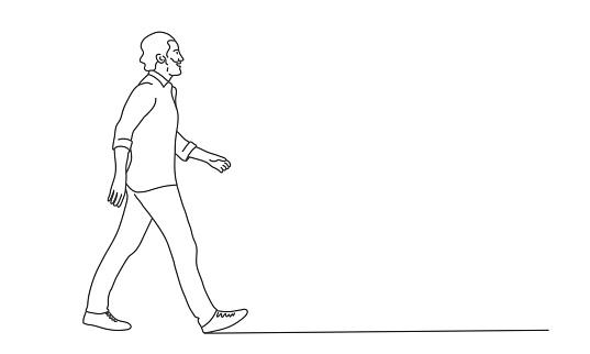 Walking man with beard.