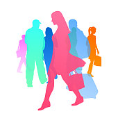 colourful silhouettes of pedestrians walking by each other