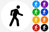 Walking Stick Figure Icon on Flat Color Circle Buttons. This 100% royalty free vector illustration features the main icon pictured in black inside a white circle. The alternative color options in blue, green, yellow, red, purple, indigo, orange and black are on the right of the icon and are arranged in two vertical columns.