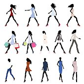 Set of walking female silhouettes in fashion clothes with bags