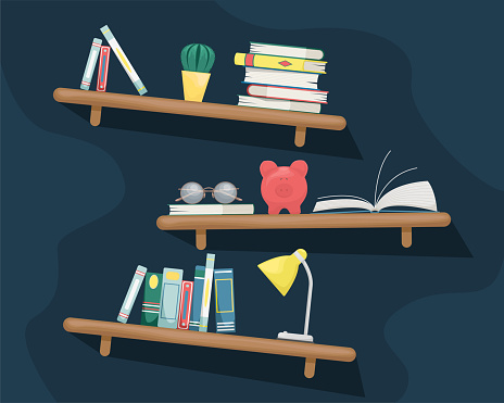 Wall shelves with books, cactus, piggy Bank, table lamp and glas