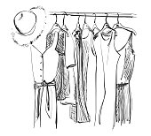 Wardrobe sketch. Clothes on the hangers. Summer dress and hat