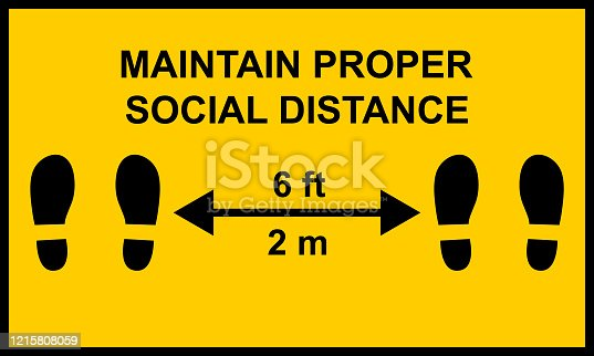 Warning sign reminding people to keep a minimum distance of six feet or two meters between them.  Social distance public health measures to prevent further spread of Covid-19 infections.
