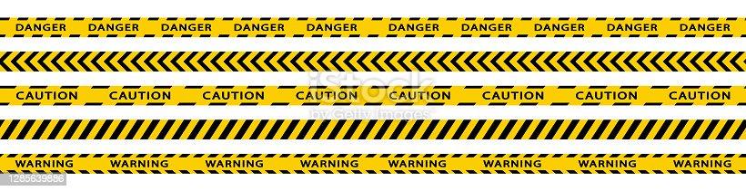 istock Warning stripes set. Danger tapes. Yellow stripes border. Caution tape. Do not cross. 1285639886
