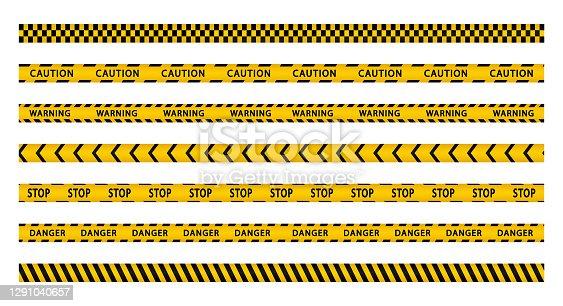 istock Warning stripes set. Police line, danger stripes. Yellow stripes border. Caution tape. Do not cross. 1291040657