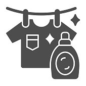 Washed T-shirt and bottle solid icon, Household concept, Stain remover bottle with hanging cloth sign on white background, clothes cleaning and washing symbol glyph style. Vector graphics.