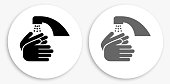 Washing Hands Black and White Round Icon. This 100% royalty free vector illustration is featuring a round button with a drop shadow and the main icon is depicted in black and in grey for a roll-over effect.