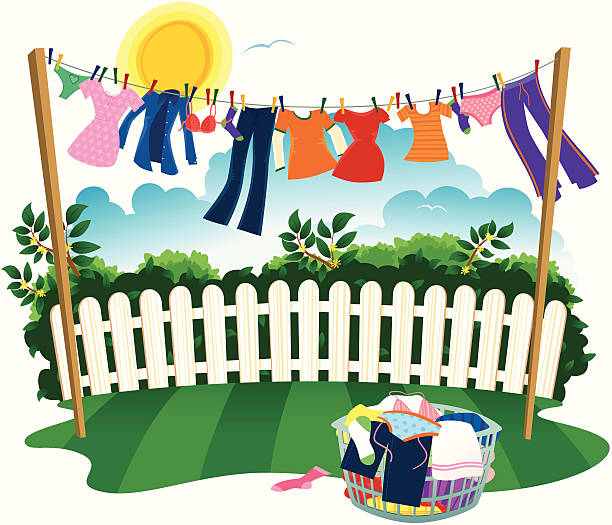 Washing line and drying clothes Isolated illustration of a clothes line full of washing drying on a windy, but sunny day. In the foreground is a basket of laundry ready to take in. laundry basket stock illustrations