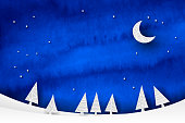 Watercolor and papercut winter scene with night sky, moon and fir trees
