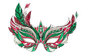 Beautiful festive Christmas carnival mask with red and green feathers isolated on white background. Watercolor ink illustration.
