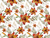 Watercolor seamless pattern made of tiger lilies and wild herbs.