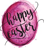 Vector EPS10 brightly colored Easter egg painted in watercolor. Happy Easter text is placed overtop.