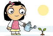 Abbie watering plant in her garden.