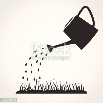 Dark grey watering can sprays water drops above lawn.