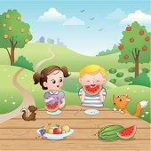 Kids eating watermelons.